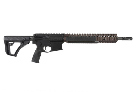 The Daniel Defense M4A1 5.56 rifle features a 14.5 inch pinned barrel and an FDE RIS II handguard