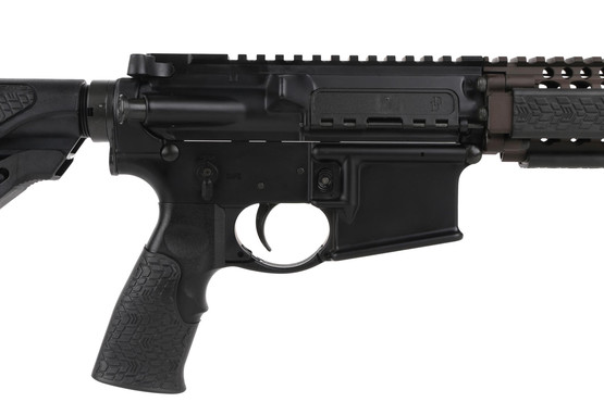 The Daniel Defense M4A1 rifle features a rubber overmolded pistol grip and black receivers