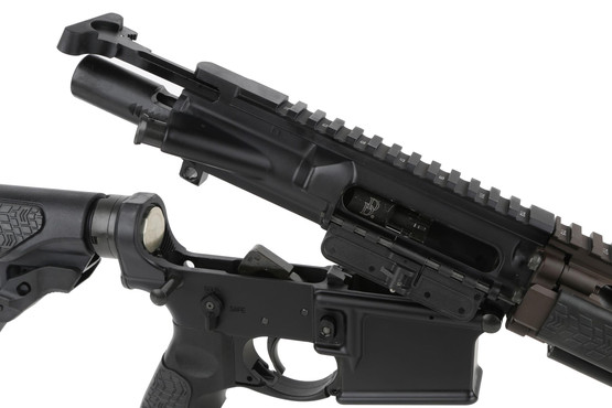 The Daniel Defense M4 5.56 AR rifle features a manganese phosphate coated bolt carrier group and standard charging handle