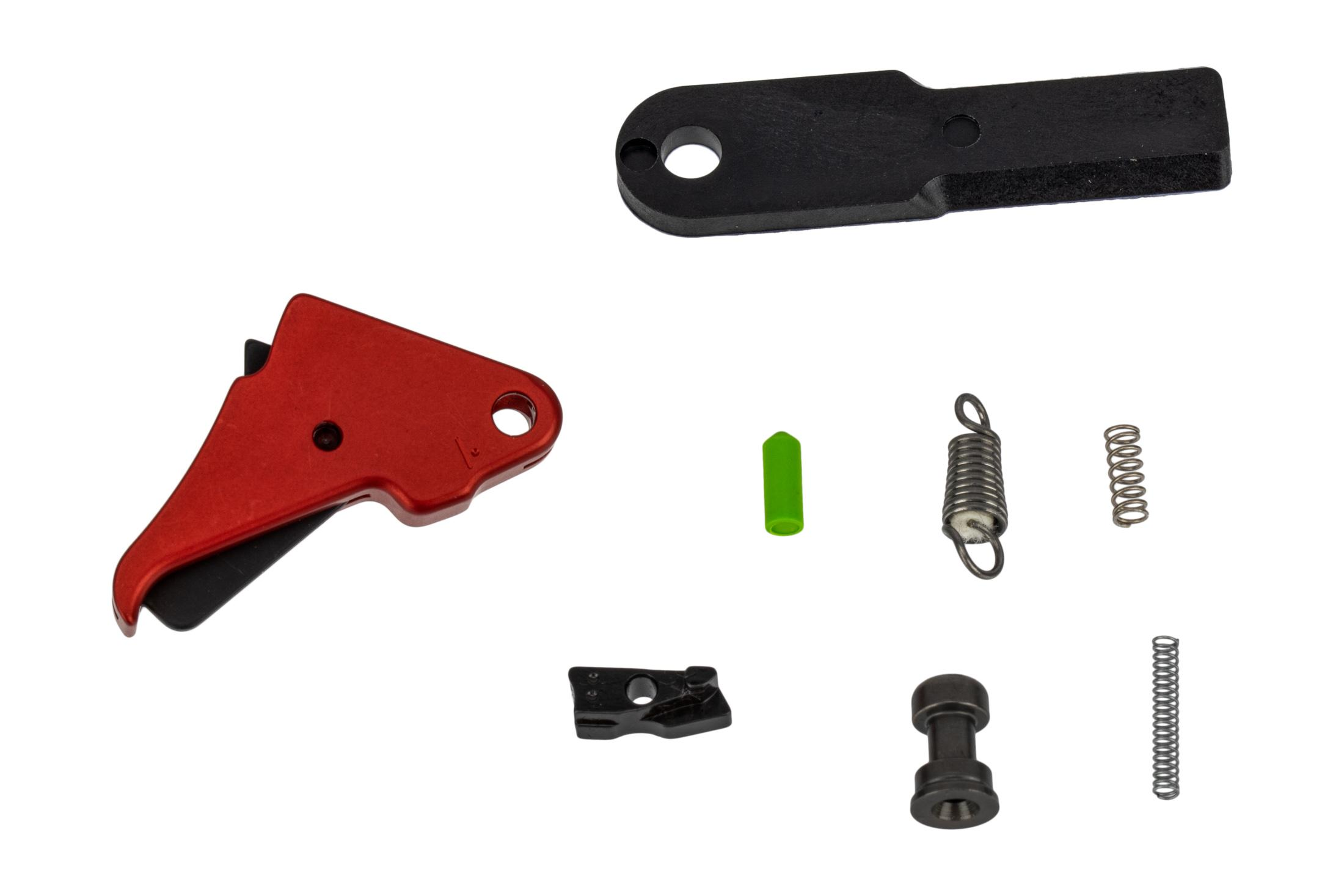 Apex Tactical M&P Shield flat trigger features a red anodized finished