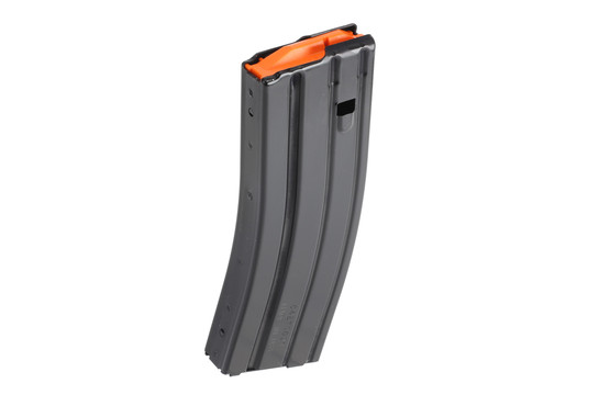 The C Products 30 round 5.56 AR-15 magazine is made from aluminum with an orange follower