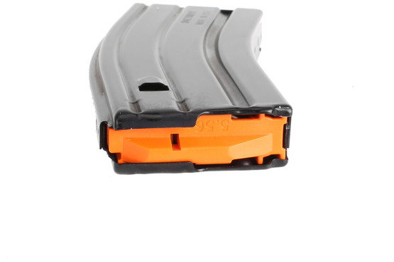 The C Products 556 magazine features an orange anti tilt follower and stainless steel spring