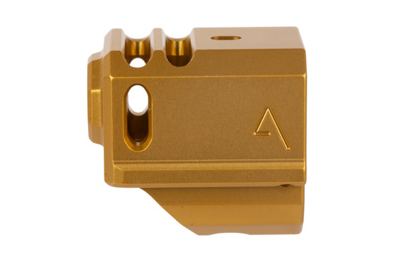 The Agency Arms 417 gold anodized Glock compensator as a front sight hole for extending the length of your sight picture
