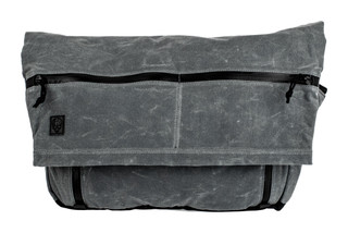 The Grey Ghost Gear Wanderer bag is made from waxed canvas with a charcoal grey color