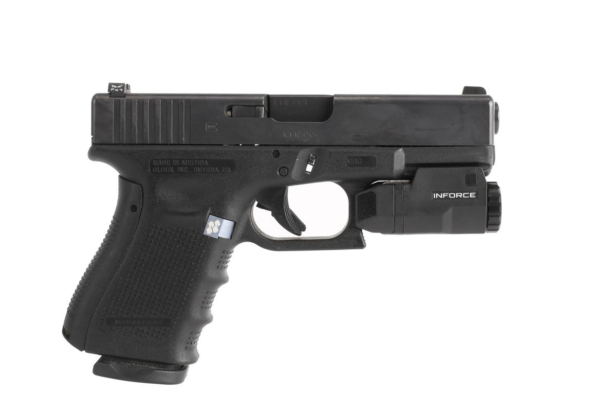 The Inforce gun light attached to a glock handgun