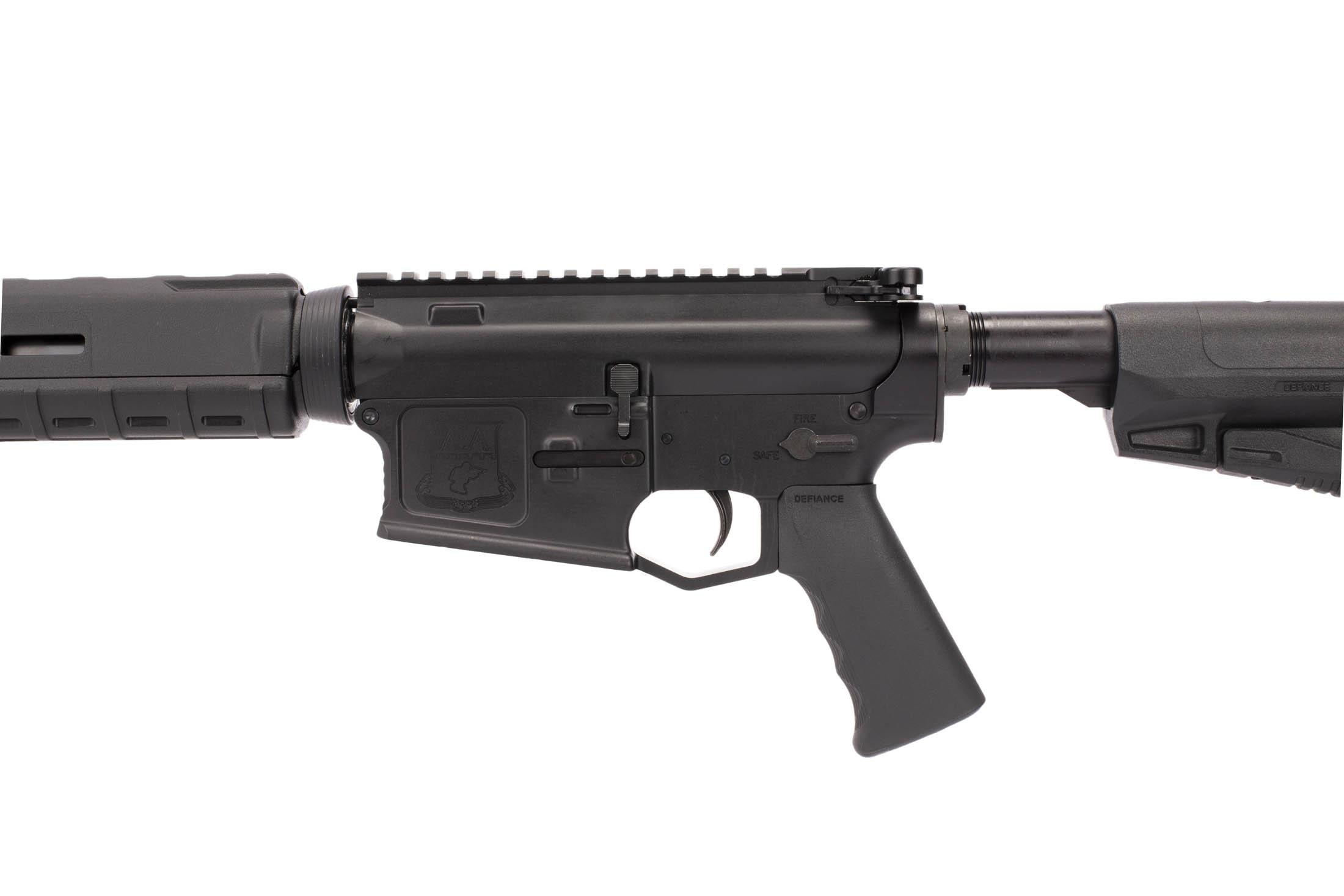 Adams Arms 16 in gas piston AR rifle has an extended trigger guard, Defiance pistol grip, and MIL-SPEC safety