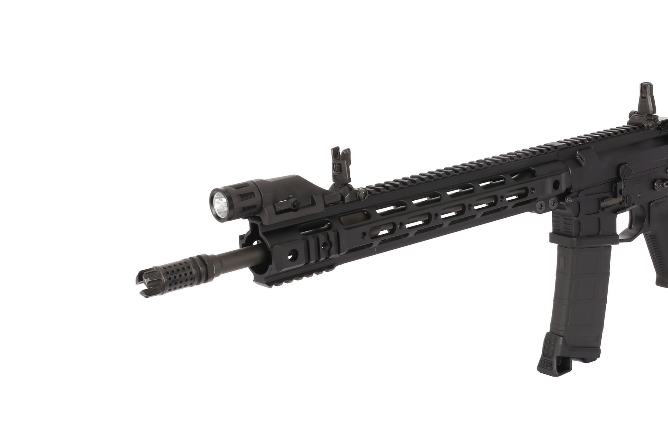 The Inforce tactical light attached to an AR-15 handguard
