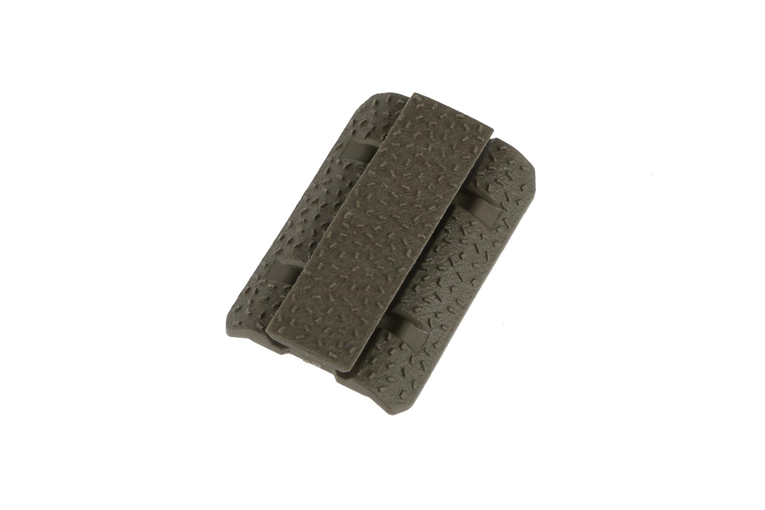 The Magpul Industries od green m-lok rail cover features an aggressive no slip texture
