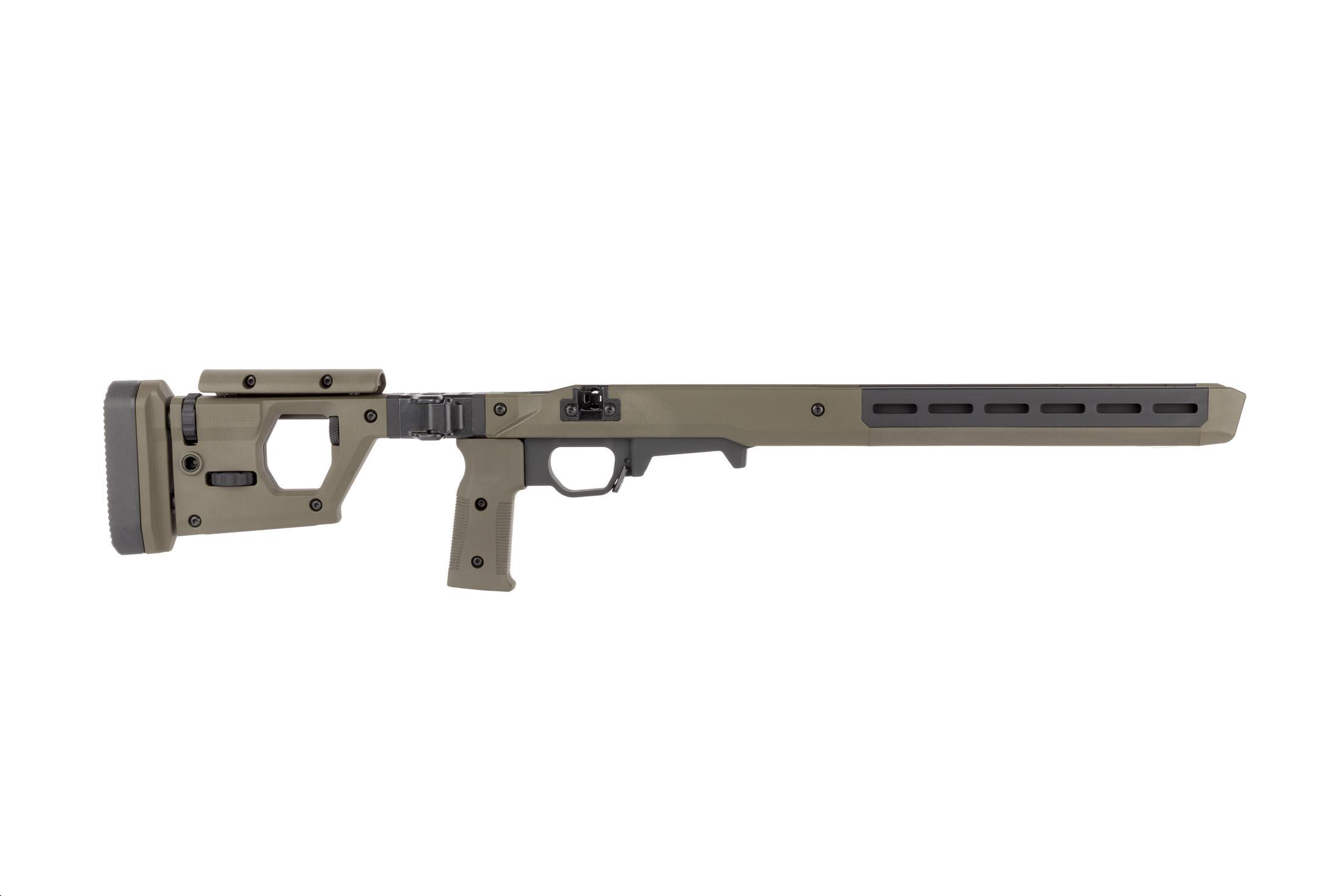 Magpul olive drab green PRO 700 rifle chassis features adjustable comb and length of pull on the folding stock.
