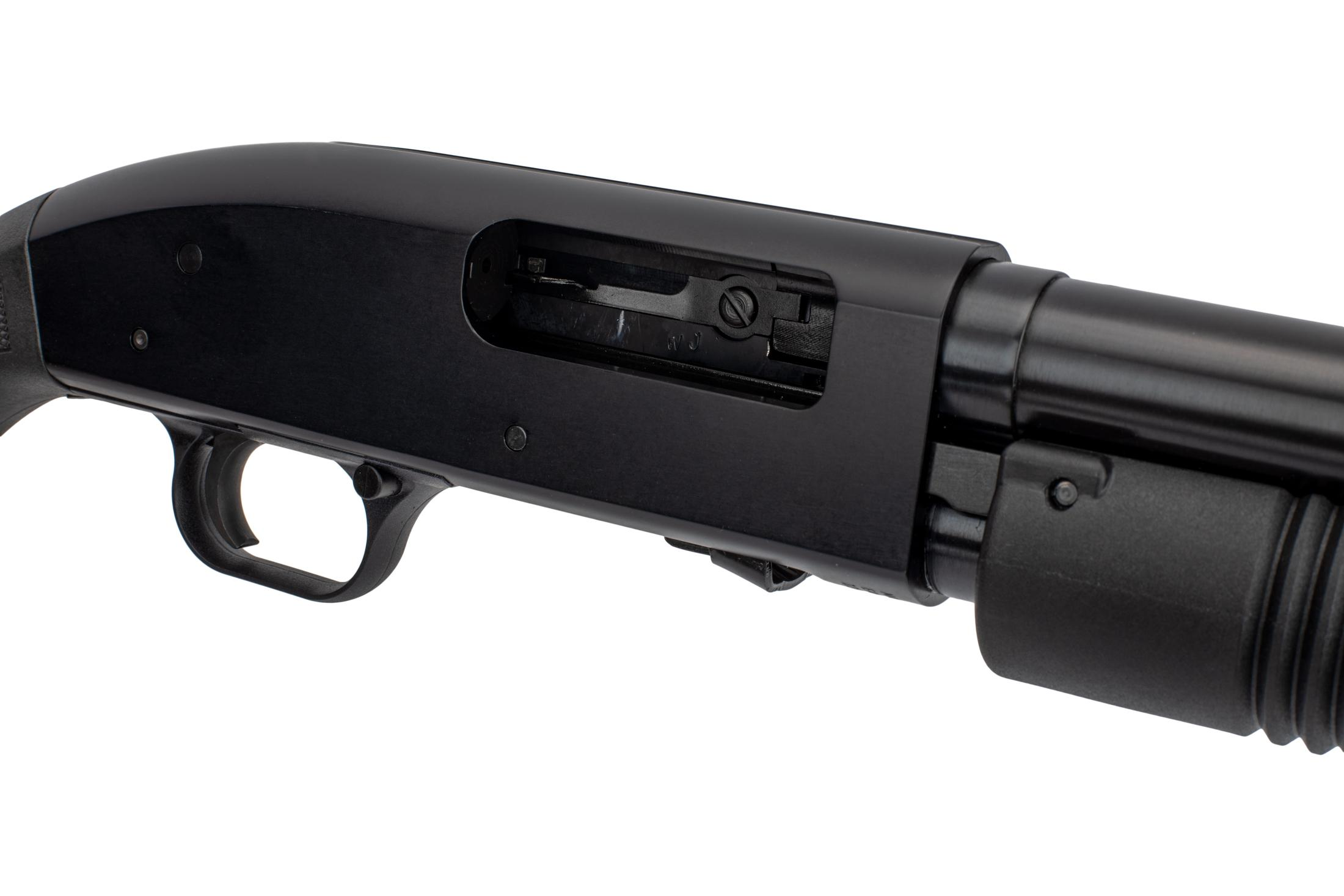 "Mossberg 3 12 gauge Maverick 88 pump action shotgun features an 18.5"" cylinder bore barrel."