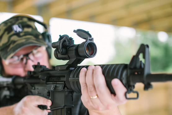 The Primary Arms advanced red dot sight attached to an M4 style rifle