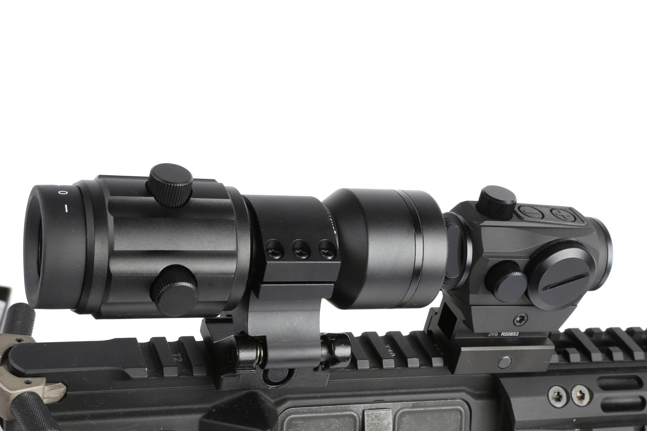 The Primary Arms 6x magnifier for red dot sights attached to an AR15