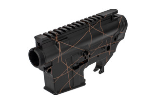 The Shellback Supply ar15 receiver set features a black and FDE anodized splash pattern finish