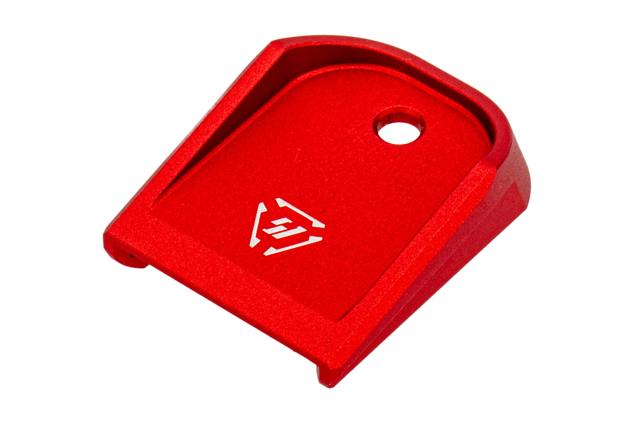 The Strike Industries red anodized aluminum glock magazine base plate is compatible with most models