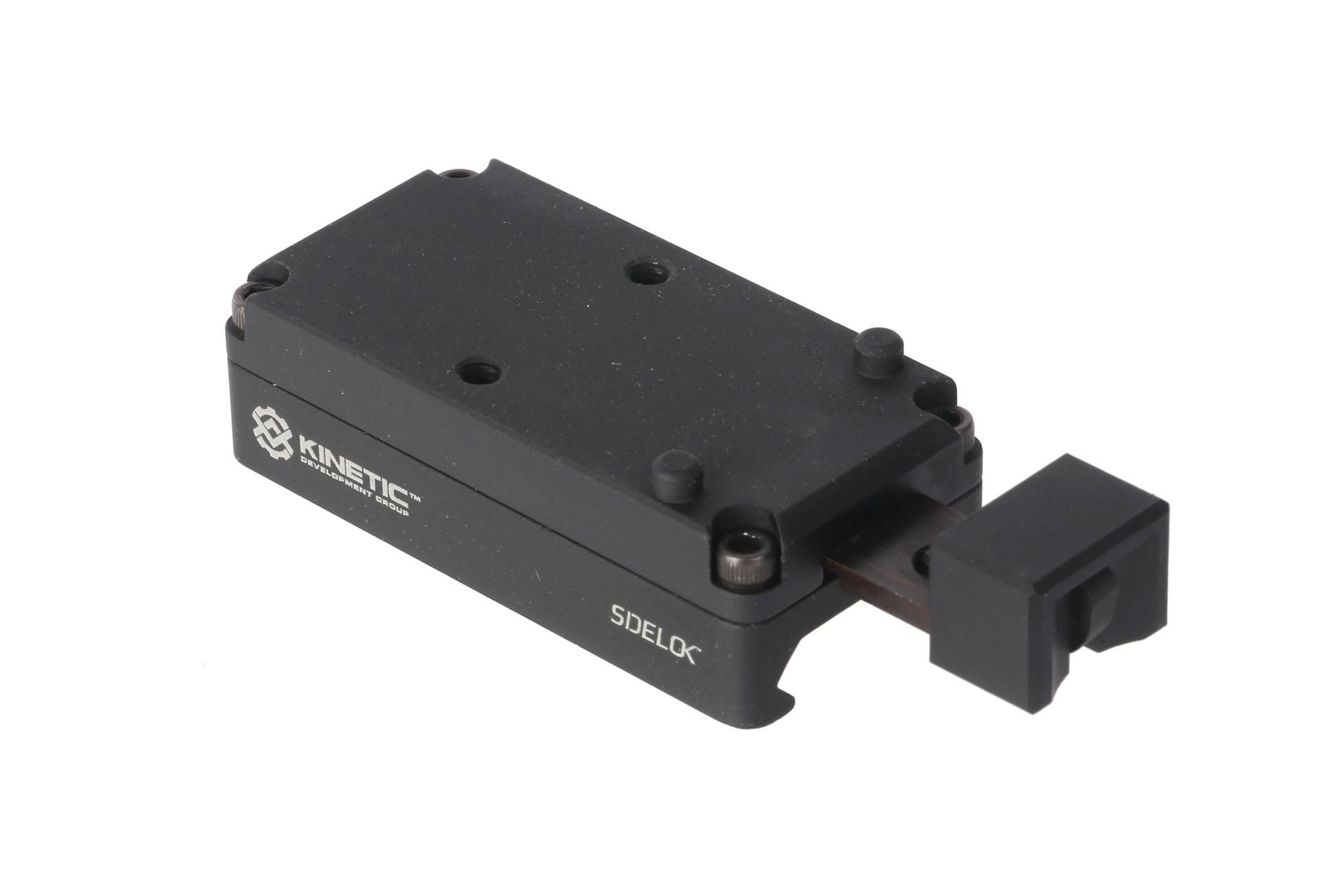 Kinetic Development Groups SIDELOK Trijicon RMR low mount instantly locks to the rail with a push button release