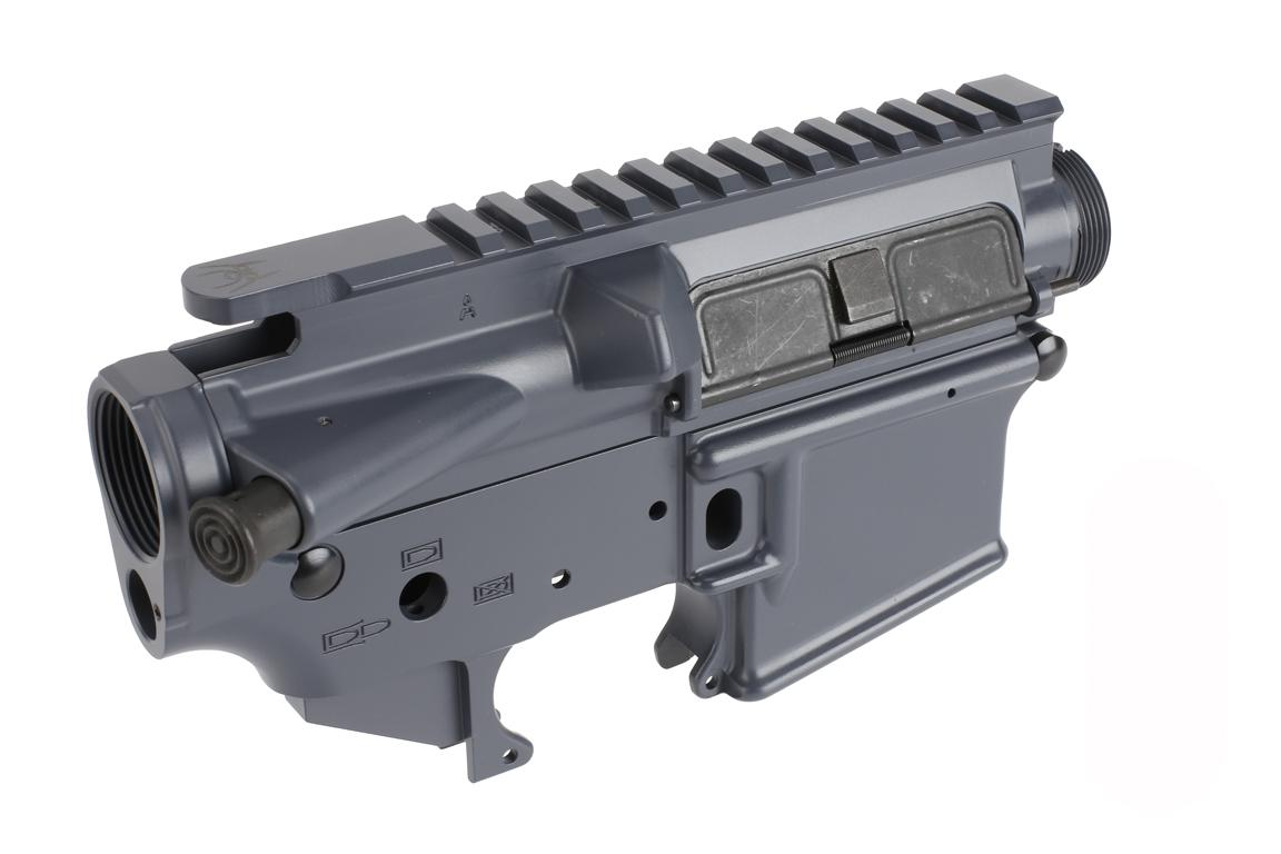 The Spikes Tactical AR-15 stripped lower and upper receiver set is assembled with forward assist and dust cover