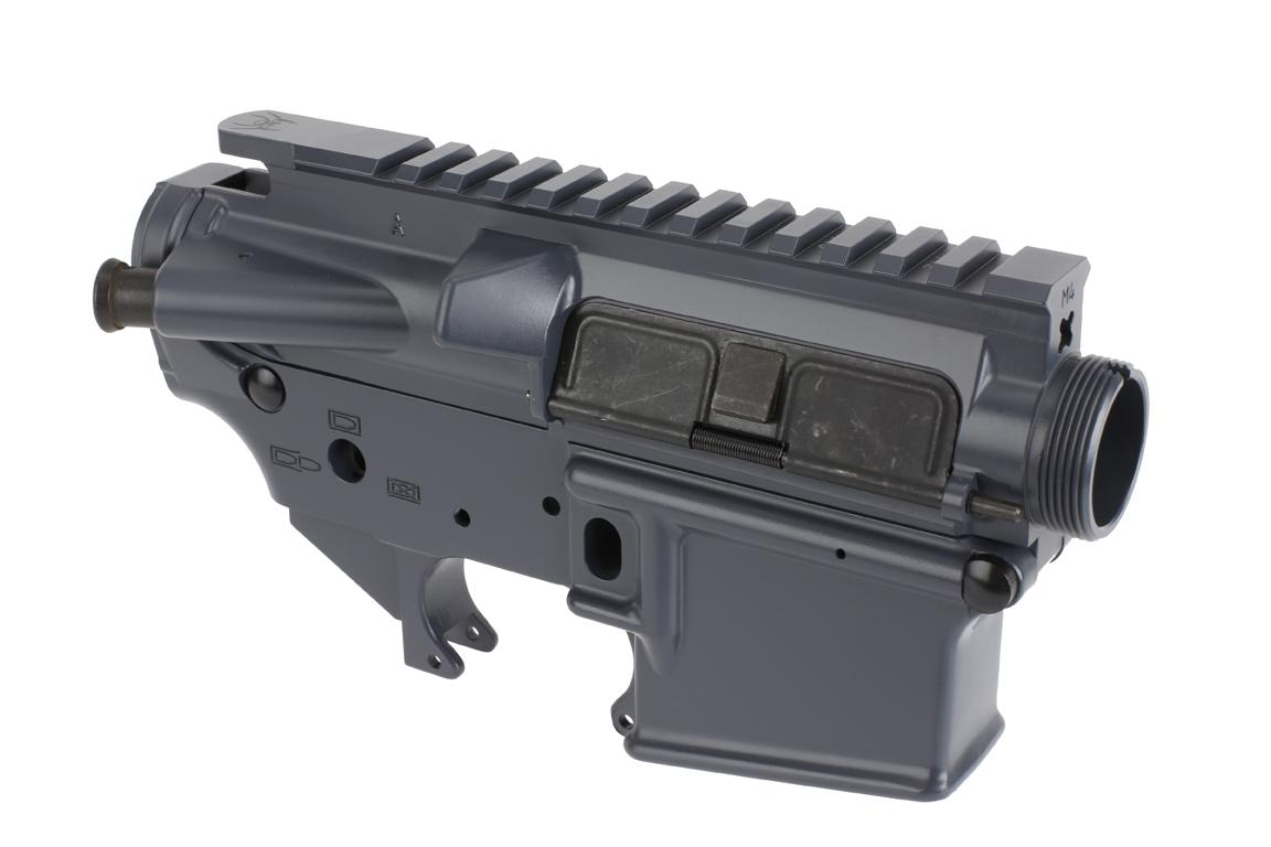 The Spikes Tactical Stripped AR-15 lower and upper receiver set features an engraved spider logo on the picatinny rail