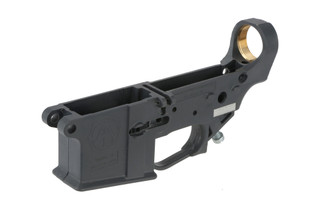 The Tennessee Arms Company Hybrid Polymer AR-15 lower receiver in stealth grey features brass inserts for the threaded parts