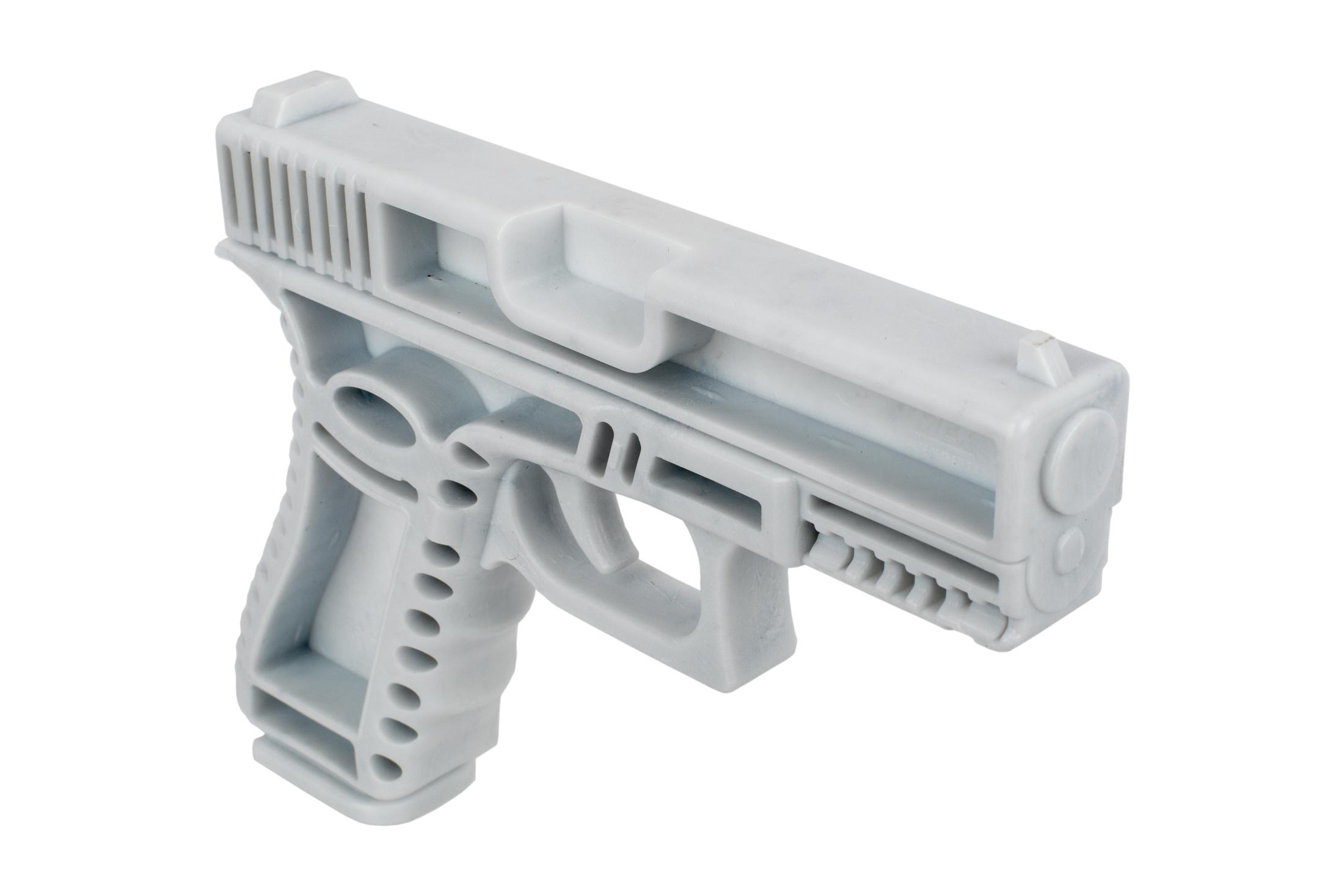 CAA Training Handgun is durable white injection molded plastic to survive harsh training use.